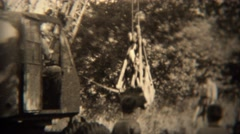 1938: Steam shovel type gasoline powered excavator digs drops dirt.  TRYON, NC Stock Footage