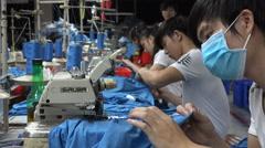 Textile production factory, manual labor, focus, precision, Vietnam, Asia - stock footage