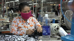 Senior woman at work in a textile factory in Vietnam, Asian ethnicity Stock Footage
