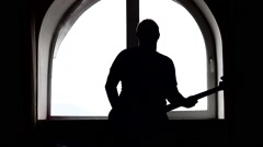 A silhouette of a bass guitar player Stock Footage