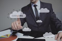 Human finger pressing high tech glowing modern cloud service interface touch Stock Photos