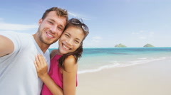 Couple on beach vacation taking selfie smart phone romantic in love - stock footage