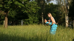 Mother With a Child Look Play on the grass Stock Footage