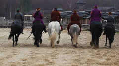 Brave actors in medieval costumes practicing horse-riding before performance Stock Footage