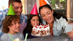Family celebrating birthday together Stock Footage
