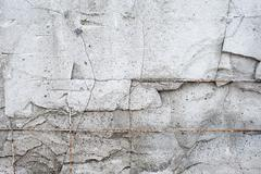 Texture cement wall of destroyed construction with fittings - stock photo