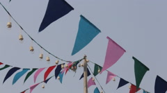 Colorful party flags on the windy sky Stock Footage