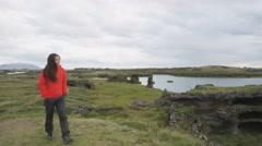 Hiking woman wearing hardshell jacket on hike - healthy outdoor lifestyle Stock Footage