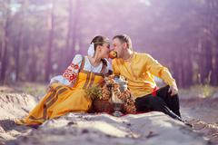 Young couple in russian national dress Stock Photos