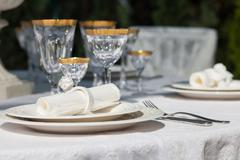 Table setting with napkin and win glasses Stock Photos
