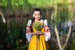 Beautiful girl in russian national clothes Stock Photos