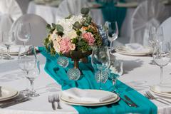 Elegance table set up for wedding in turquoise - stock photo