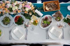 Table set and salad for a wedding reception top view - stock photo
