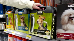 Woman buying Wahl pro clipper kit inside Walmart store Stock Footage