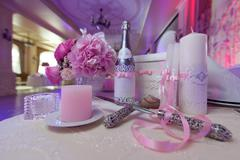 The blade and the knife to cut the cake. Champagne, candles and flowers as we - stock photo