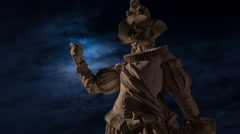 Sculpture of a medieval man and the Moon at night, Bruchsal, time lapse Stock Footage