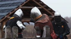 Knights checking their weapons and armor before a very important upcoming fight - stock footage