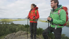Hikers enjoying view of nature during hiking trek in beautiful landscape Stock Footage