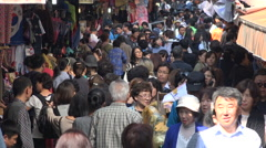 Crowds of people visit a busy popular shopping alley in Seoul, South Korea Stock Footage