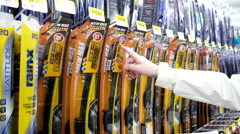Woman buying wiper blade inside Walmart store Stock Footage