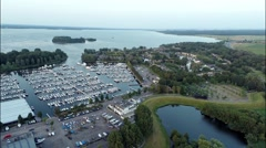 Aerial view of large boat dock with lake in the background Stock Footage