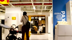 IKEA high speed  motion view Young mother chooses furniture for a new home Stock Footage