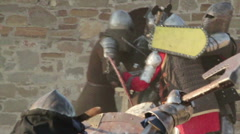 Knights in battle helmets and chain mail Stock Footage
