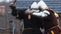 Bloody battle of men in ancient clothes and steel armor, cruelty has no limits - stock footage