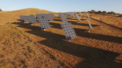 Solar Panel Array in California Golden Rolling Hills Aerial 4K Stock Footage