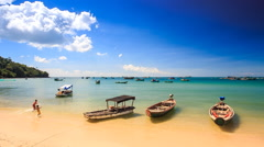 Camera Moves to Vietnamese Tourist Boats at Beach up to Horizon - stock footage
