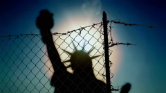 Broken fence statue of Liberty silhouette Stock Footage