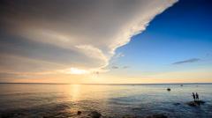 Sunlight Reflection Sunpath Fishermen in Sea at Sunset Stock Footage