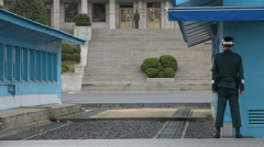 Panmunjom border facilities, North South Korea, soldiers standing guard Stock Footage