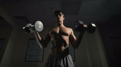 Fit Athlete Working Out Biceps - Dumbbell Concentration Curls - stock footage