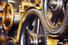 Large cog wheels in the motor - selective focus Stock Photos
