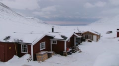 People unload car in front of the cabin in Longyearbyen, Norway. Stock Footage
