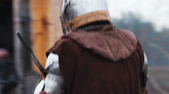 Stock Video Footage of End of fight between two medieval knights, historical tournament reenactment