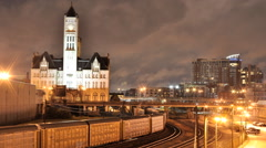 Train leaving Station as Clouds Blow past old Nashville Building Timelapse Stock Footage