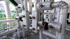 Pipes and valves at a factory - stock footage