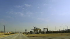 Energy pylons, oil and power station in the desert. Stock Footage