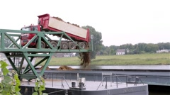 Sand truck unloading cargo on a ship Stock Footage