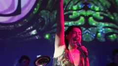 Lolita Milyavskaya perform on stage of nightclub. Raise one hand. Big screen Stock Footage