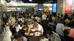 People enjoy lunch in a popular food court in Taipei, Taiwan Stock Footage