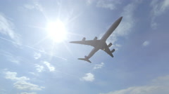 Flying Airbus A340-600 airliner with no logos. 4K sunny weather footage Stock Footage