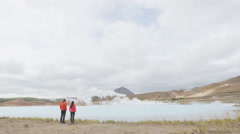 Iceland travel people by geothermal hot spring on travel holidays vacation Stock Footage