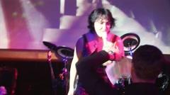 Lolita Milyavskaya sing on stage of nightclub. Raise stand for text. Man dance Stock Footage