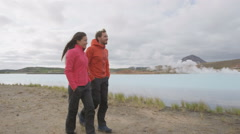 Iceland tourists travel people by hot spring on travel holidays vacation - stock footage