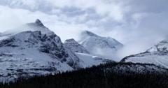 Windblown clouds blowing across Canadian Rockies, Jasper National Park Stock Footage