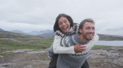 Couple doing piggyback having fun laughing joyful together in love Stock Footage