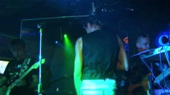 Dima Bilan in cap perform with band on stage of nightclub. Gold microphone Stock Footage